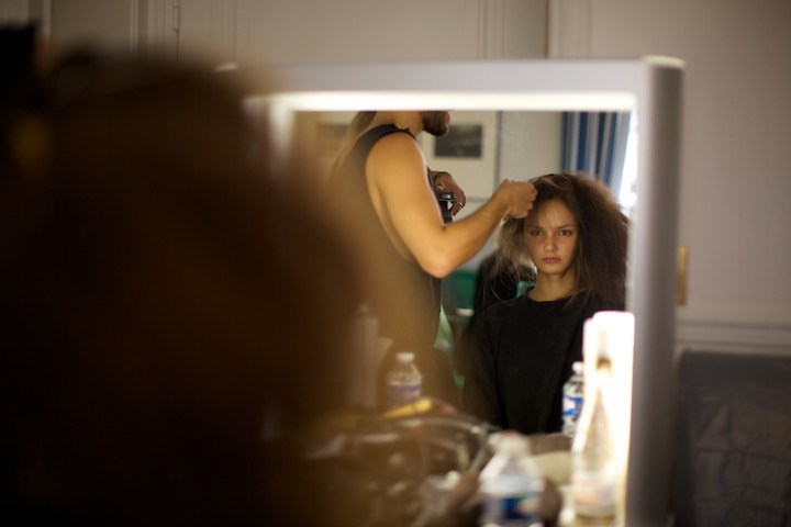 Model for Anne Sofie SS15 backstage getting prepped for hair styling. image credit akin abayomi for Livingfash