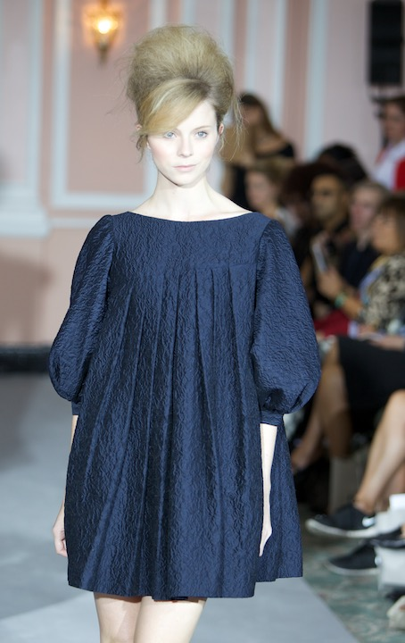 model wearing a dark blue above the knee dress at the Paul costello SS15, London Fashion Week.