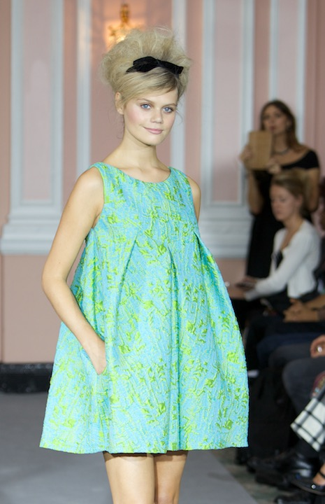 Model wearing a bright green tone shirt dress during the Paul Costello fashion show at London Fashion Week, SS15