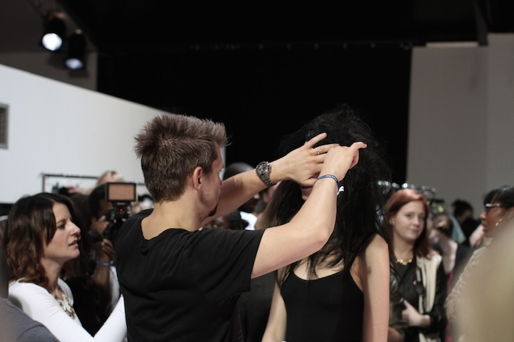 image akin abayomi, image of model backstage getting her hair styled