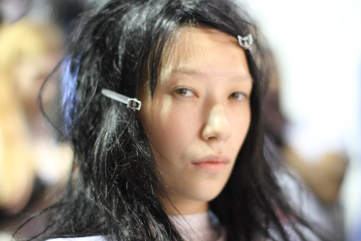 model getting hair styled backstage LFW, SS14 Mark Fast show, image credit akin abayomi